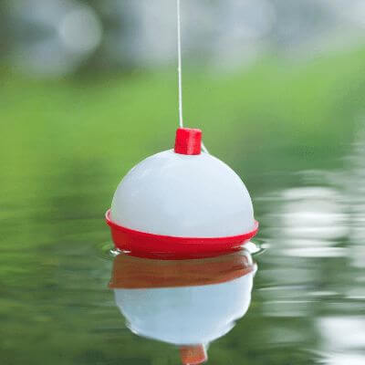 A fishing bobber floating in the water