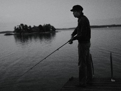 Night fishing off of a pier